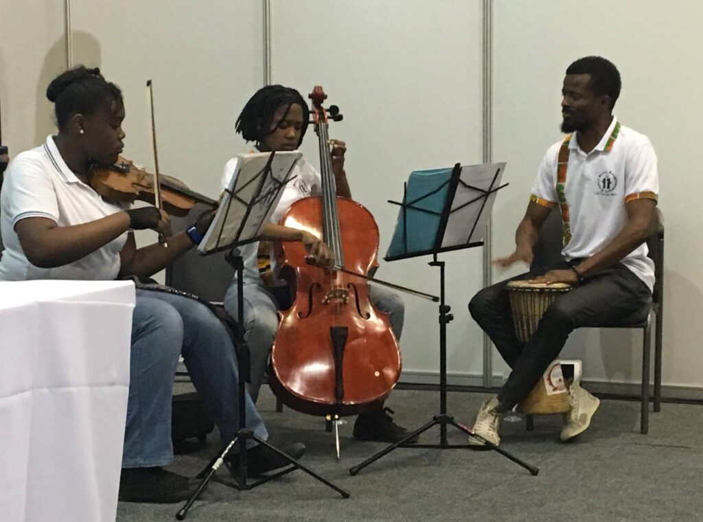 Music Enlightenment Project founder Adeyemi Oladiran and students Kamogelo Mthembu and Camila Lungile Mathebula perform on September 27, 2016 at a special event at the CITES negotiation in Johannesburg.
